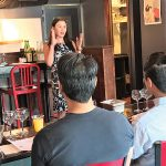 Monica Samuels, Sake Master and National Sales Manager, Vine Connections presenting to guests.