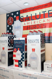 "Salute American Vodka's red, white and blue military canteen-inspired bottle is available in 750ml bottles. The company aims to become ""the number one spirit contributor to veterans' charities nationwide."""