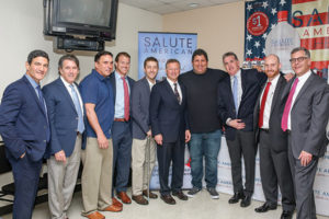 Gene Sepe, CEO and President, Brescome Barton; Steve Lentz, General Sales Manager, Brescome Barton; Scott Sweitzer; Michael Lutz, Salute American Vodka Operations Manager; Ryan Dunne, Salute American Vodka Sales Representative; Lieutenant General (Retired) Ray Palumbo; Tony Siragusa; Brian Hughes; Mike Heins, Trade Development Manager, Brescome Barton; Robert Sussler, Executive Vice President and General Manager, Brescome Barton.