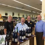 Kevin Visocchi, Store Manager, Amity Wine & Spirits; Michael Schlink, President, Schlink Haus; Roy Hannon, General Manager, Amity Wine & Spirits; Dan Hogan, East Region Manager, Wein-bauer, on July 5 during an in-store tasting and bottle signing at Amity Wine & Spirits in New Haven.