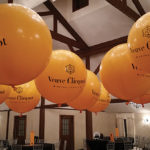 Bottles of Veuve Clicquot decorated the tables while branded balloons drew attention aloft during the New Year's Eve celebration at Farmington Gardens.