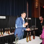 Noah King-Smith, Slocum & Sons, speaking with a guest about Don Abraham Tequila.