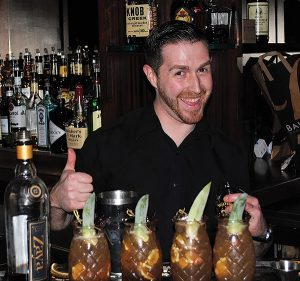 Max Cuscuna of Hudson Grille next to his winning cocktail during the competition on April 24.