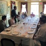 Pierre Casenave (standing) welcoming guests to the trade luncheon at Bernard's in Ridgefield on May 4.