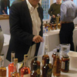 Howard Asadow, District Sales Manager, Allan S. Goodman pouring tastes from Onyx Spirits Company.