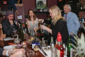 Markoja mixes her cocktail as Chris Parrott, Owner, Little River Restoratives, Christen LaRochelle of Slocum & Sons and Jack Baker, Co-owner, Litchfield Distillery, look on.