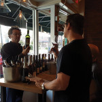 Steve Wynn, Owner, Wine Bros., pouring for Steve Patterson of Metacom Kitchen in Warren.