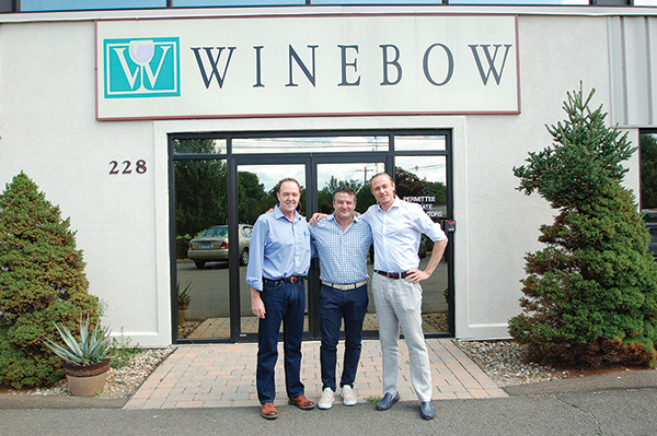 Tom Simpson, Vice President and General Manager, Winebow-Martin Scott Wines, Connecticut; Giuseppe Santarelli, North American Sales Manager, Avignonesi Wines; Joseph Di Marco, Regional Manager, Classica International, in front of the Winebow-Martin Scott's Connecticut headquarters in Wallingford.
