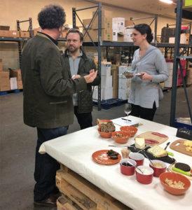 Steve Wynn, Founder of The Wine Bros., talking with Matthew MacCartney, Executive Chef, Jamestown Fish and Emily Brakenhoff of Jamestown Fish.