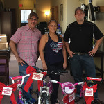 Project Broken Wheel volunteers delivering bikes to Adoption Rhode Island. Frank Martucci, General Manager of Beverage Operations, Twin River Casino; Alaina Bart, Volunteer, Project Broken Wheel; Paul Zagami, Volunteer, Project Broken Wheel.